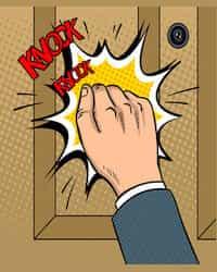 Hand knocking the door